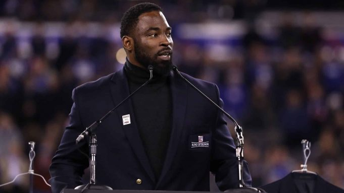 EAST RUTHERFORD, NJ - NOVEMBER 14: 2016 Giants Ring of Honor Inductee Justin Tuck speaks during the halftime ceremony of the game between the Cincinnati Bengals and the New York Giants at MetLife Stadium on November 14, 2016 in East Rutherford, New Jersey.