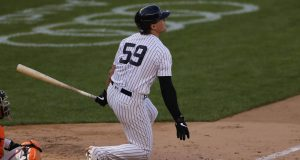 NEW YORK, NY - SEPTEMBER 12: Luke Voit #59 of the New York Yankees hits a walkoff single against the Baltimore Orioles during the tenth inning at Yankee Stadium on September 12, 2020 in the Bronx borough of New York City. The Yankees won 2-1.