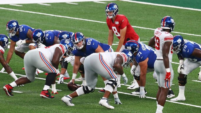 EAST RUTHERFORD, NEW JERSEY - AUGUST 28: Daniel Jones #8 of the New York Giants looks to pass the ball during the Blue and White scrimmage at MetLife Stadium on August 28, 2020 in East Rutherford, New Jersey.