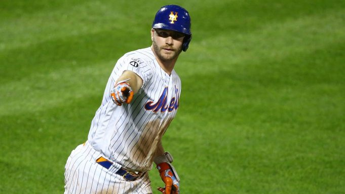 NEW YORK, NEW YORK - SEPTEMBER 09: Pete Alonso #20 of the New York Mets points to the bench after hitting a home run in the eighth inning against the Baltimore Orioles at Citi Field on September 09, 2020 in New York City.