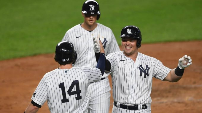 NEW YORK, NEW YORK - SEPTEMBER 15: Luke Voit #59 of the New York Yankees celebrates with Tyler Wade #14 after hitting a three-run home run during the second inning against the Toronto Blue Jays at Yankee Stadium on September 15, 2020 in the Bronx borough of New York City.