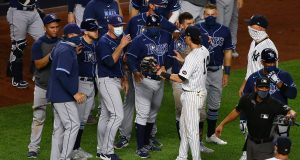 NEW YORK, NEW YORK - SEPTEMBER 01: New York Yankees and the Tampa Bay Rays exchanges words after the final out in the ninth inning at Yankee Stadium on September 01, 2020 in New York City.