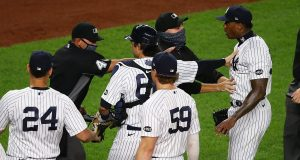 NEW YORK, NEW YORK - SEPTEMBER 01: Aroldis Chapman #54 of the New York Yankees exchanges words with the Tampa Bay Rays after the final out in the ninth inning at Yankee Stadium on September 01, 2020 in New York City.