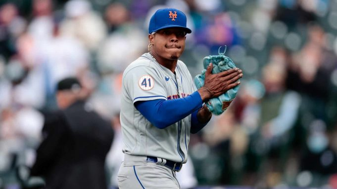 Apr 18, 2021; Denver, Colorado, USA; New York Mets starting pitcher Marcus Stroman (0) reacts at the end of the eighth inning against the Colorado Rockies at Coors Field.